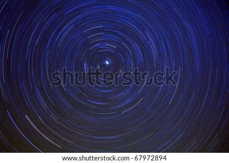 Long exposure revealing star trails. - stock photo