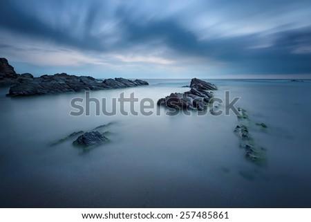 Long exposure seascape before sunrise - stock photo
