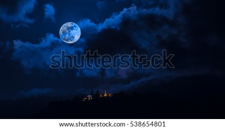 long exposure shot image of big full moon and Wat Phra That Doi Suthep temple on mountain ,Chiang mai,Thiland .