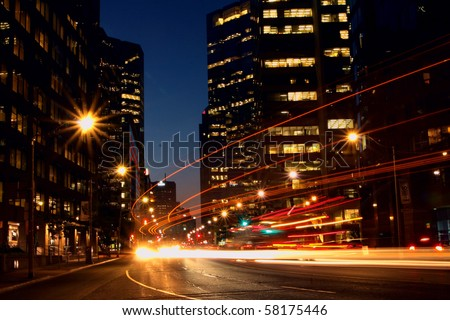 Long exposure shot of a busy street at night creating dynamic effect of the vehicle lights. photo taken Toronto Canada - stock photo