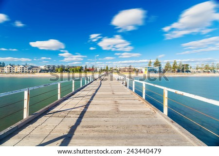 Long exposure shot of a jetty in a beach in South Australia - stock photo