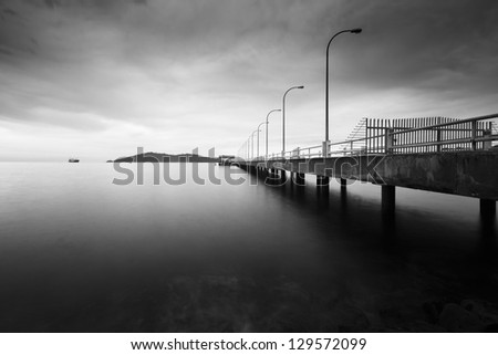 Long exposure shot of a jetty in black and white  Borneo, Sabah, Malaysia - stock photo
