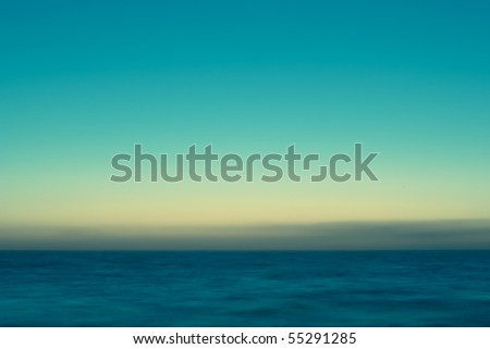 Long exposure shot of calm and misty sea early in the morning. - stock photo