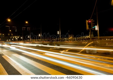 Long exposure shot of moving vehicle headlights on the road