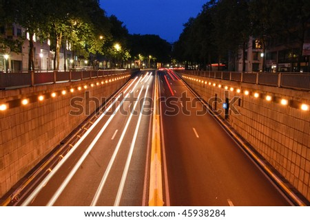 Long exposure shot of traffic going in the tunnel in Brussels - stock photo