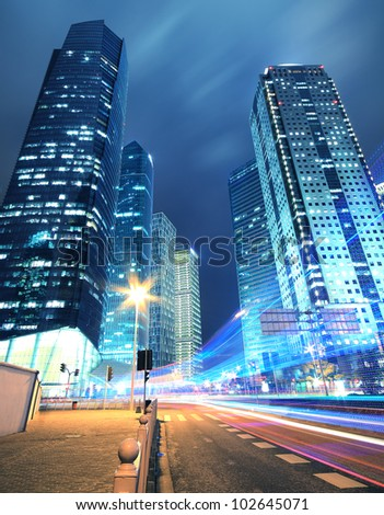 Long exposure shots of a busy street in Shanghai, the dynamic effects of the night lights - stock photo