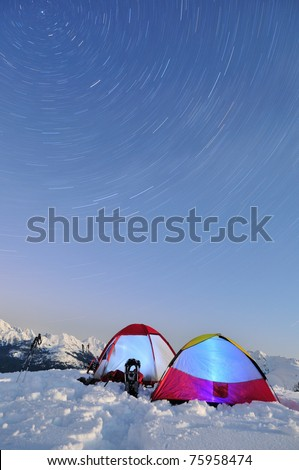 Long Exposure Star Trails and tents on Artist Point - stock photo