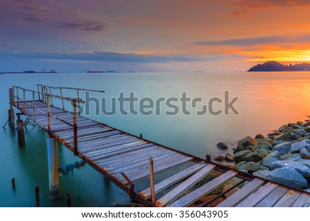 Long Exposure Sunrise Seascape with Abandon Jetty. Soft Focus, Motion Blur Due to Long Exposure Shot. Copy Space Area