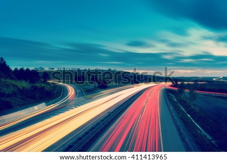 Long-exposure sunset over a highway with Instagram vintage faded effect - stock photo