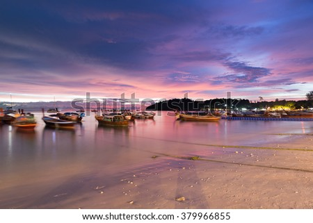 Long exposure sunset sky wave boat at Pattaya beach in Koh Lipe Island.Soft focus and motion blur due to long exposure shot - stock photo