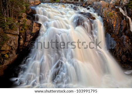 Long exposure waterfall from Chutes du Diable in Mont Tremblant Park, Quebec, Canada (Chutes du Diable meaning Demon Falls in French). Also processed for HDR to enhance contrast and details. - stock photo