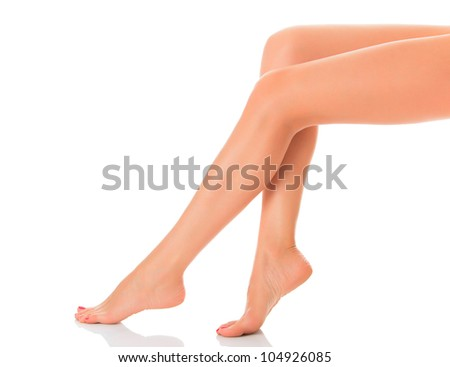 Long female legs on white background - stock photo