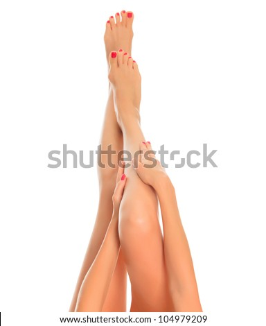 Long female legs on white background