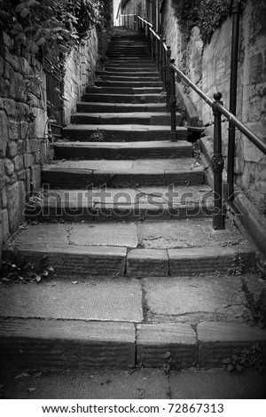Long Flight of Old Stone Steps Leading up a Dark Alleyway - stock photo
