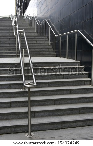 Long flight of steps and stainless steel handrails - stock photo
