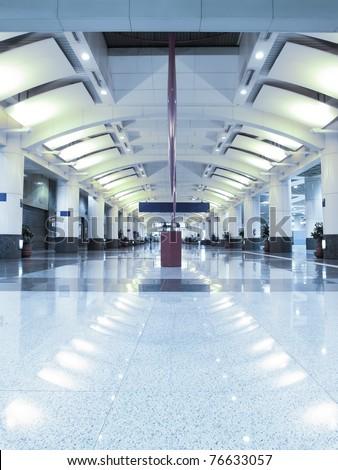 Long fluorescent hallway - stock photo