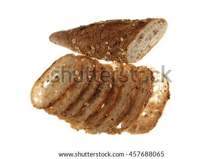 long french fresh rye baguette sliced isolated on white background - stock photo