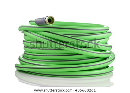 Long garden hose rolled-up isolated on white background