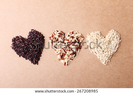 long grain rice,brown rice, keep healthy concept, brown background - stock photo