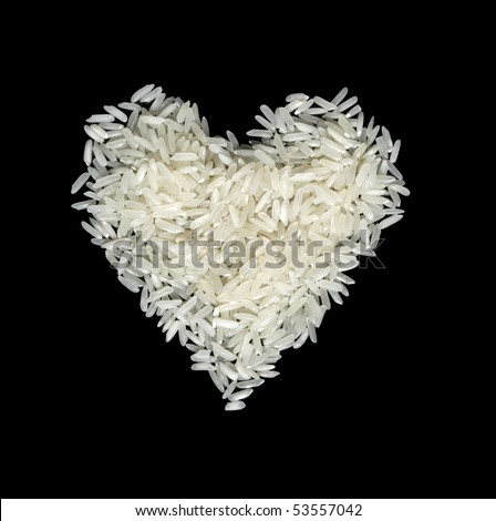 long-grain rice grains in the form of heart on a black background - stock photo