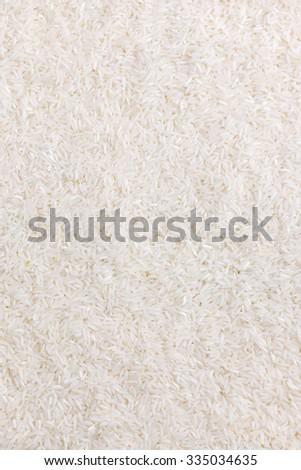Long grain white rice background. - stock photo