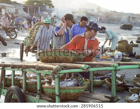 Long Hai, Ba Ria Vung Tau, Vietnam 31 May 2015: A man sorting baskets full of fish at Phuoc Hai fish market.