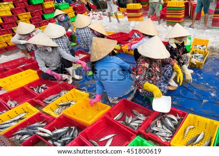 Long Hai, Vietnam - 03 July 2016:  Fish sellers in Long Hai market are preparing marine fish for the morning market