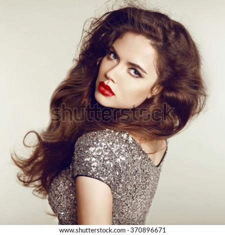 Long Hair. Beautiful Brunette Girl Portrait. Makeup. Healthy Hairstyle. Beauty Model Woman. Studio photo - stock photo