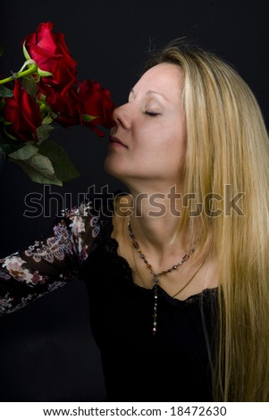 long hair blonde woman with bunch of flowers
