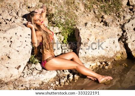 Long hair girl in bikini on river. - stock photo