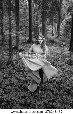 Long-hair girl in  dress at forest. BW - stock photo