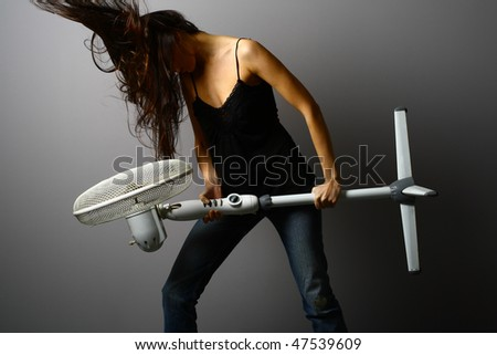 Long hair girl with fan - stock photo