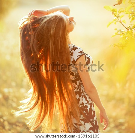 Long hair gorgeous woman in sunshine. - stock photo