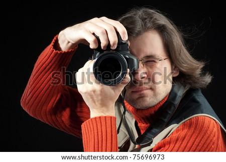 Long hair man with camera - stock photo