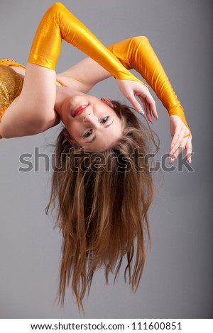 long hair of red lips model in yellow shine dress hang down in photo ...