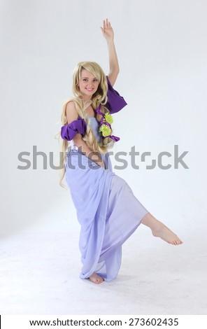 Long hair princess dancing in studio - stock photo
