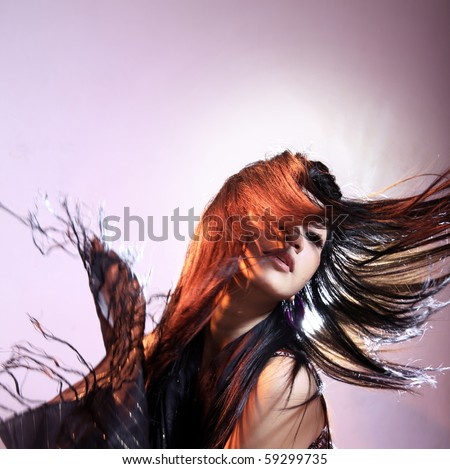 long hair style in action - stock photo