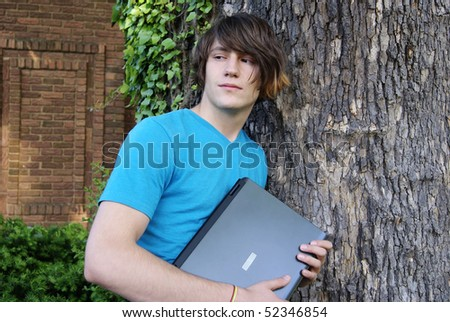 Long Hair Teen outside with Laptop - stock photo