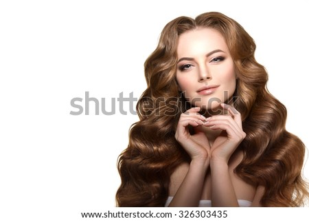 Long hair. Waves Curls Hairstyle. Hair Salon. Fashion model with shiny hair. Woman with healthy hair girl with luxurious haircut. Hair loss Girl with hair volume.  - stock photo