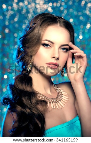 Long hair. Waves Curls Hairstyle. Hair Salon. Fashion model with shiny hair. Woman with healthy hair girl with luxurious haircut. Hair loss Woman with hair volume.  - stock photo