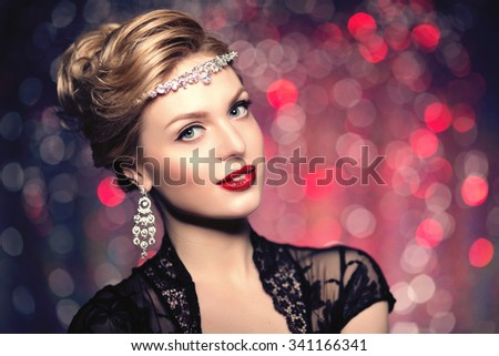 Long hair. Waves Curls Hairstyle. Hair Salon. Updo. Fashion model with shiny hair. Woman with healthy hair girl.  - stock photo