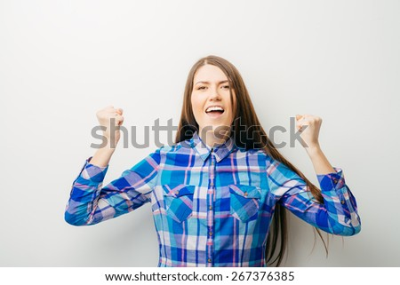 long-haired beautiful girl is happy with his fists, isolated on white background - stock photo