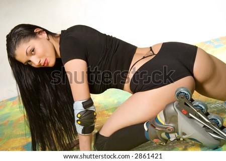 Long haired brunette with roller skates - stock photo