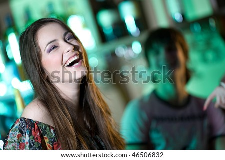Long-haired girl in bar - stock photo