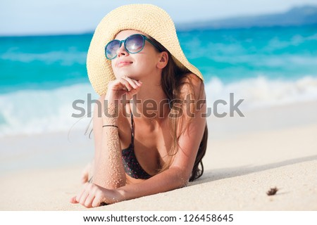 long haired girl in bikini on tropical bali beach - stock photo