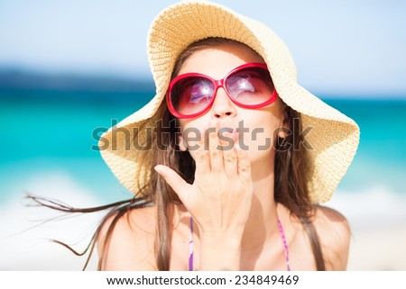 long haired girl in straw hat blowing a kiss on tropical boracay beach - stock photo