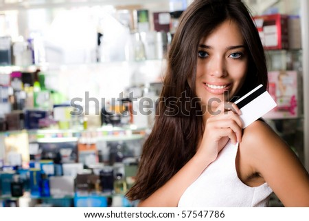 Long-haired girl with card - stock photo