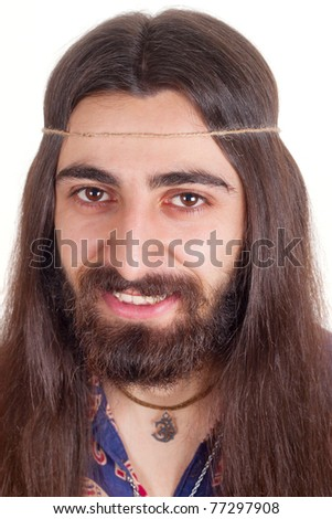 Long-haired handsome smiling hippie man - stock photo