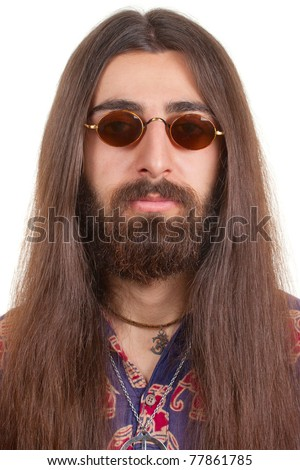 Long-haired hippie man in a glasses - stock photo