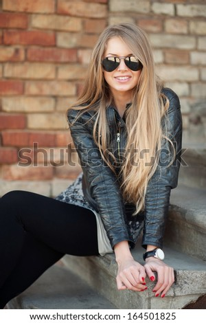 Long haired sexy woman in sunglasses - outdoor portrait  - stock photo